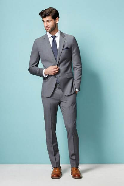 The gray notch lapel suit men 39 s wardrobe essentials for Shirt and tie for charcoal suit